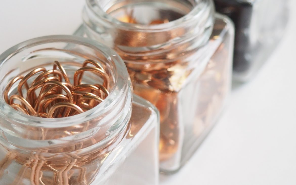 jars with paper clips and office supplies
